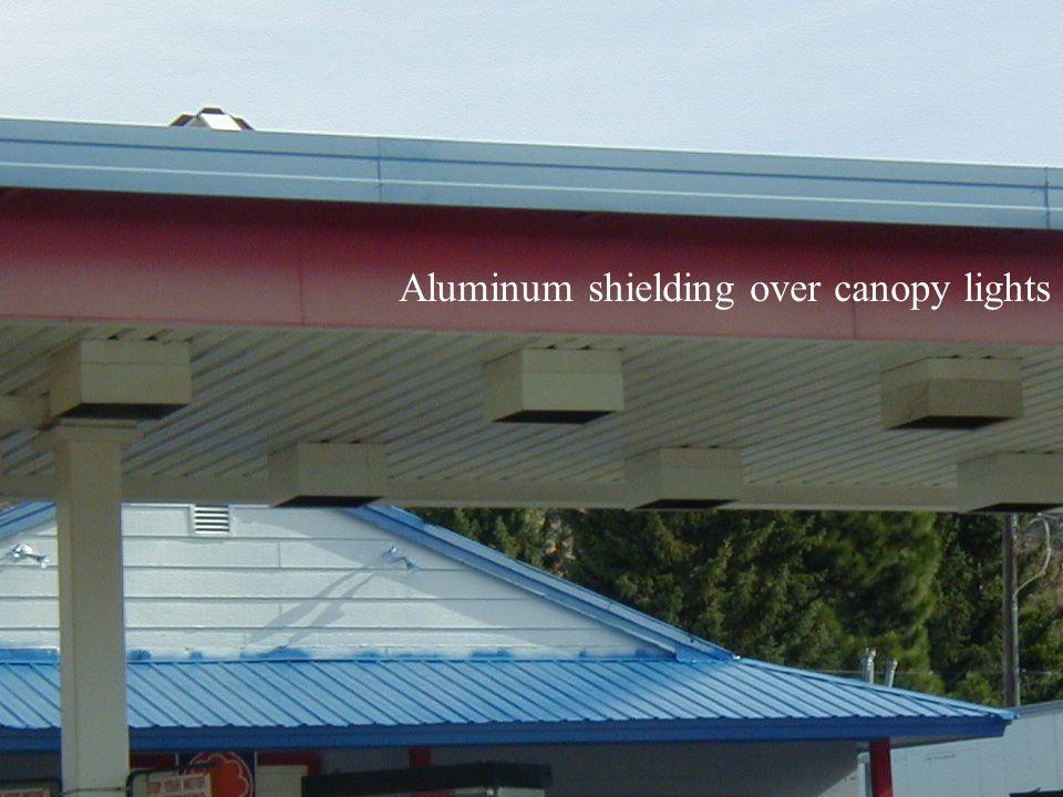 Aluminum shielding over canopy lights