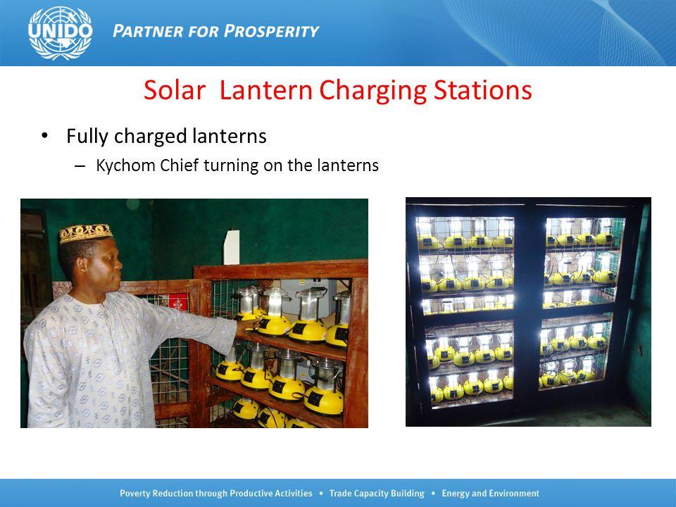 Solar Lantern Charging Stations Fully charged lanterns – Kychom Chief turning on the lanterns 8