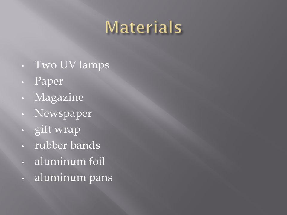 Two UV lamps Paper Magazine Newspaper gift wrap rubber bands aluminum foil aluminum pans