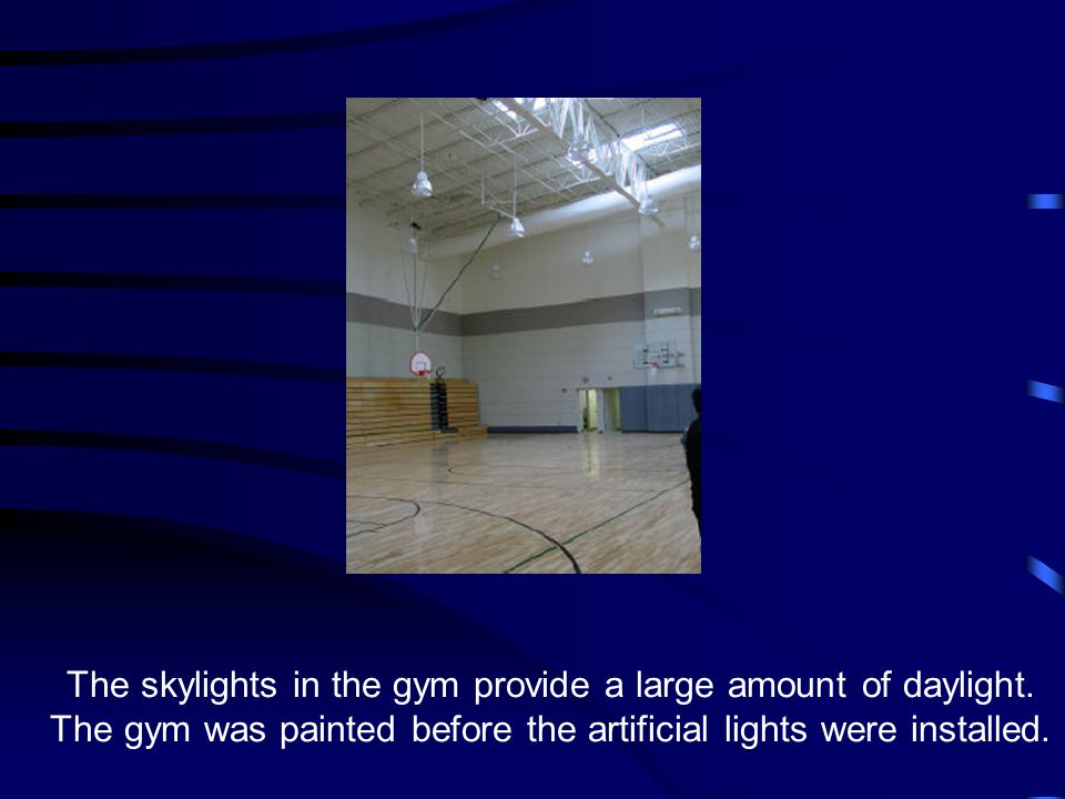 The skylights in the gym provide a large amount of daylight. The gym was painted before the artificial lights were installed.