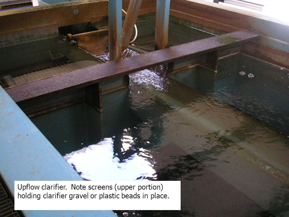 Upflow clarifier. Note screens (upper portion) holding clarifier gravel or plastic beads in place.