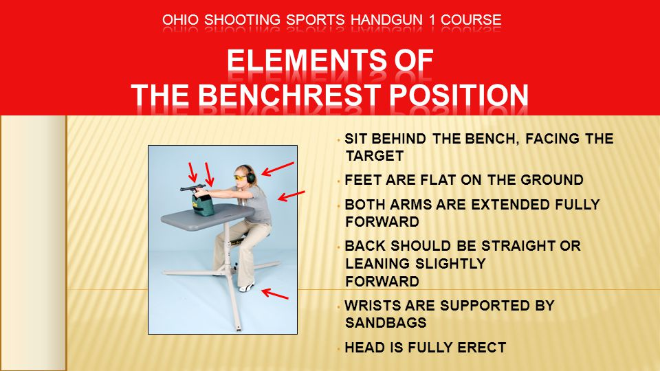 SIT BEHIND THE BENCH, FACING THE TARGET FEET ARE FLAT ON THE GROUND BOTH ARMS ARE EXTENDED FULLY FORWARD BACK SHOULD BE STRAIGHT OR LEANING SLIGHTLY F