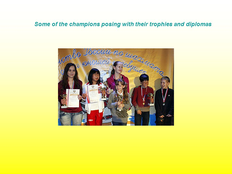 Some of the champions posing with their trophies and diplomas