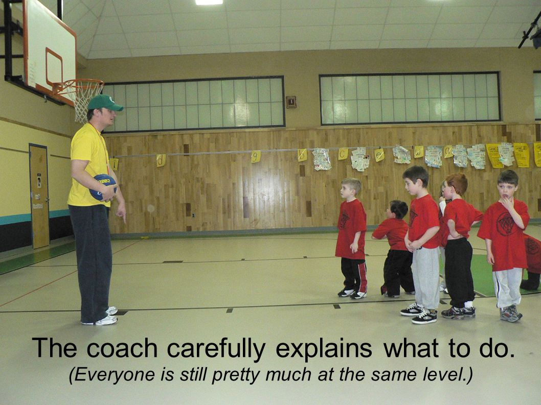 The coach carefully explains what to do. (Everyone is still pretty much at the same level.)