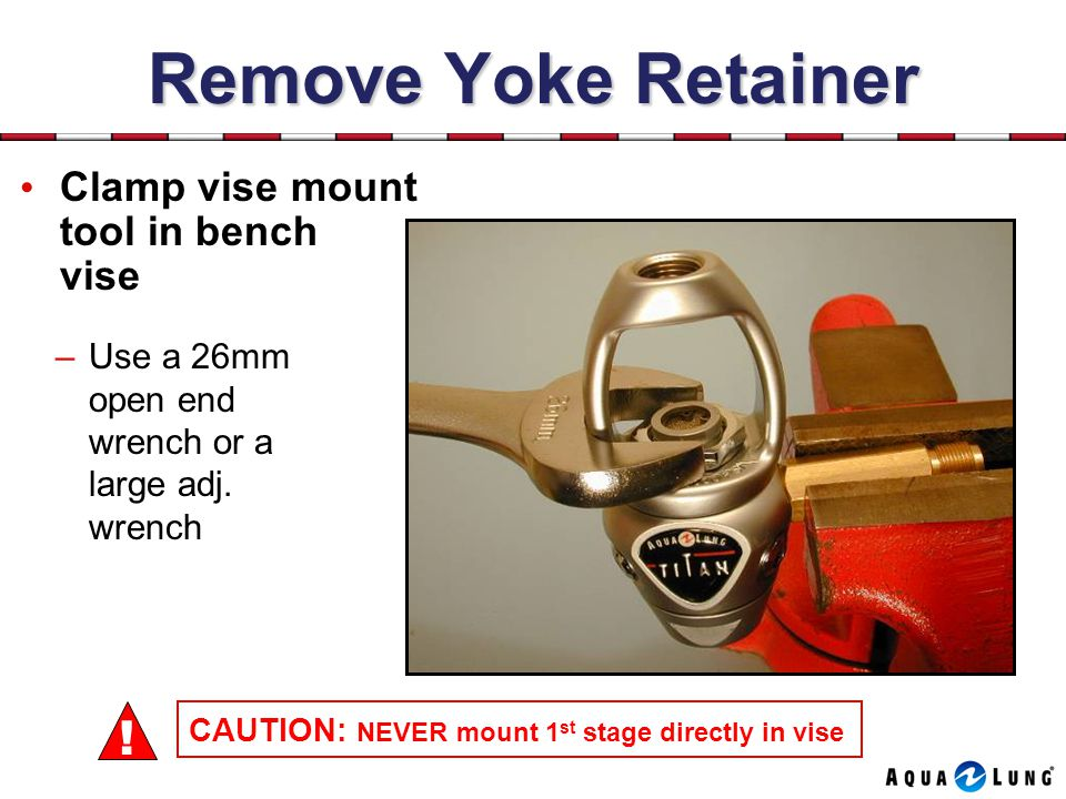 Remove Yoke Retainer Clamp vise mount tool in bench vise –Use a 26mm open end wrench or a large adj.