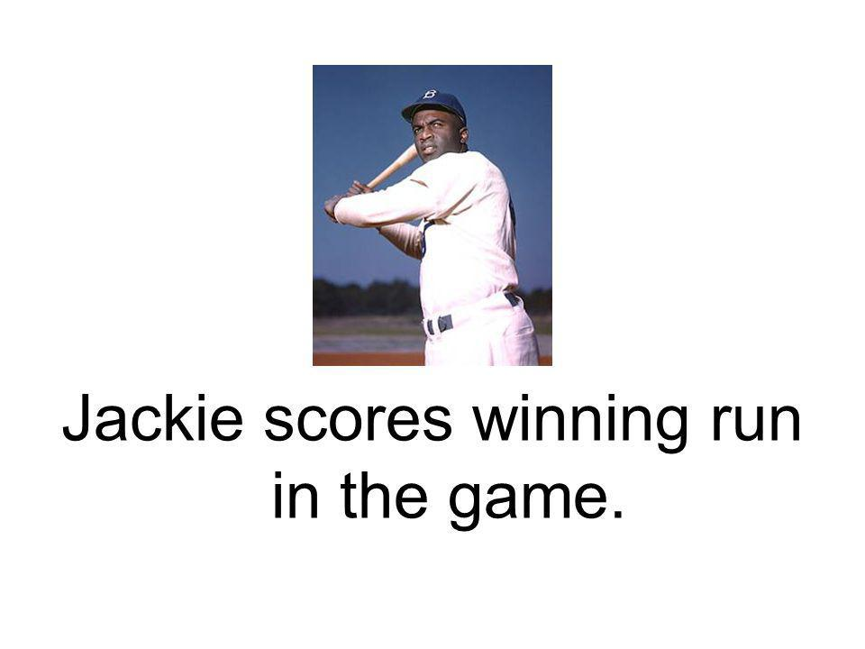 Jackie scores winning run in the game.