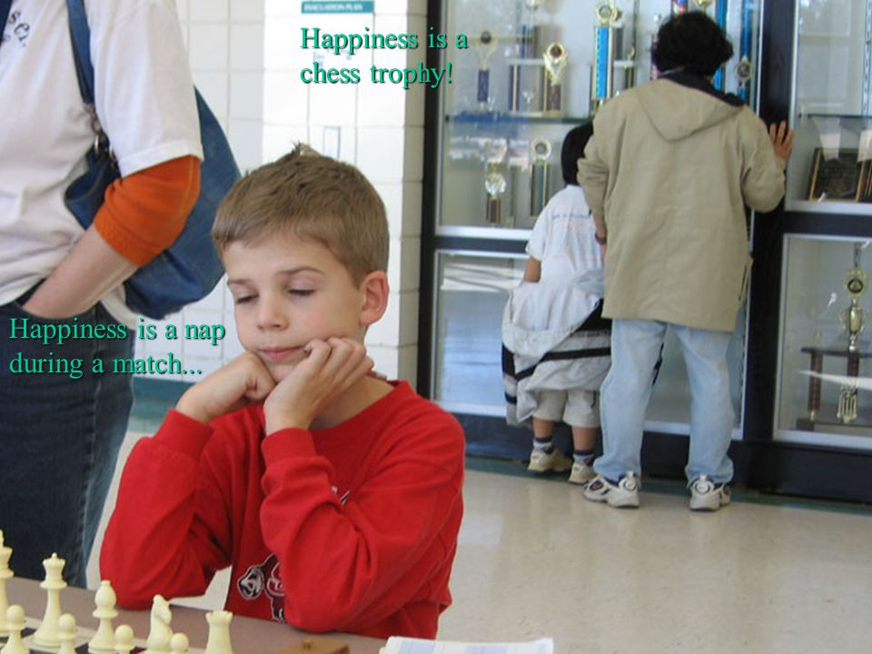 Happiness is a chess trophy! Happiness is a nap during a match...