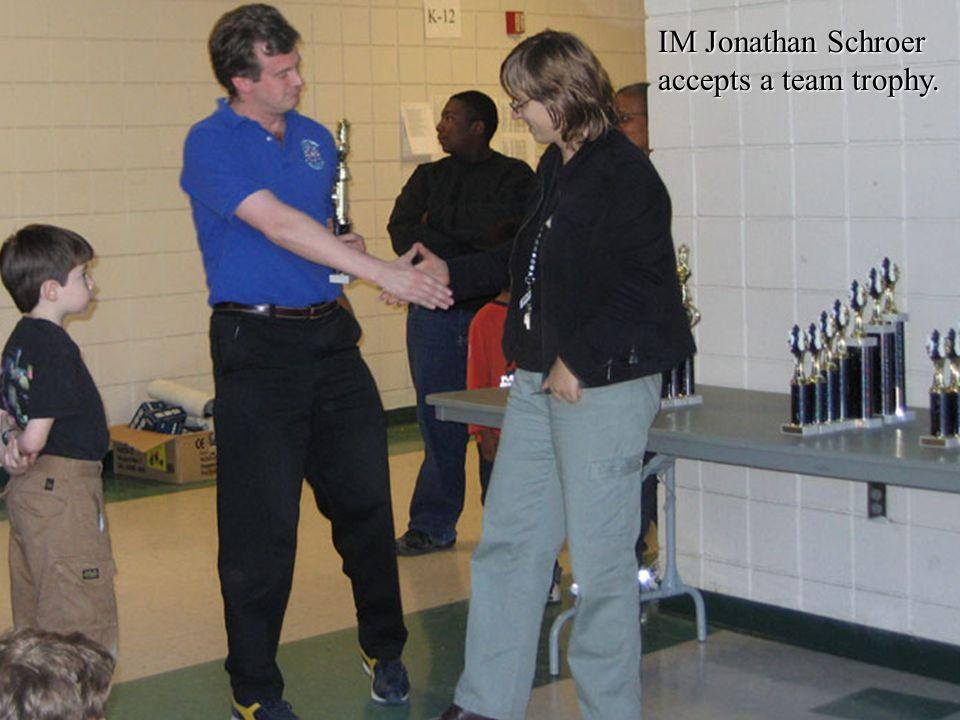 IM Jonathan Schroer accepts a team trophy.