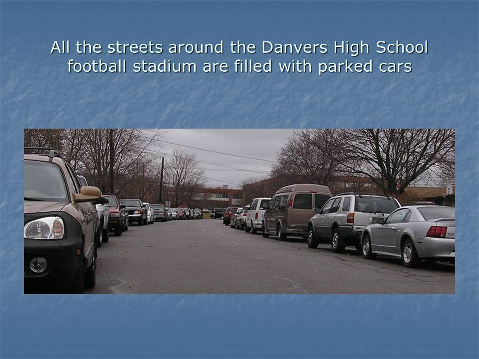All the streets around the Danvers High School football stadium are filled with parked cars