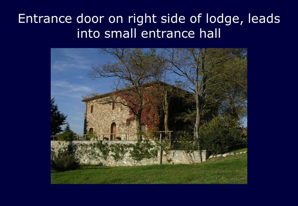 Entrance door on right side of lodge, leads into small entrance hall