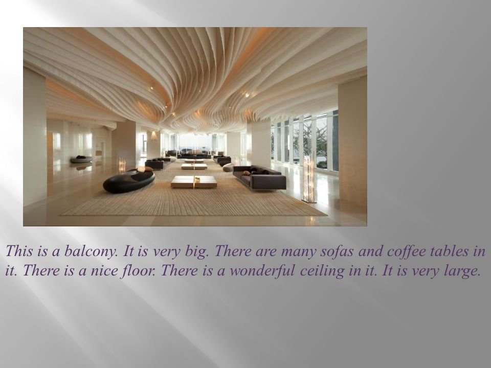 This is a balcony. It is very big. There are many sofas and coffee tables in it. There is a nice floor. There is a wonderful ceiling in it. It is very