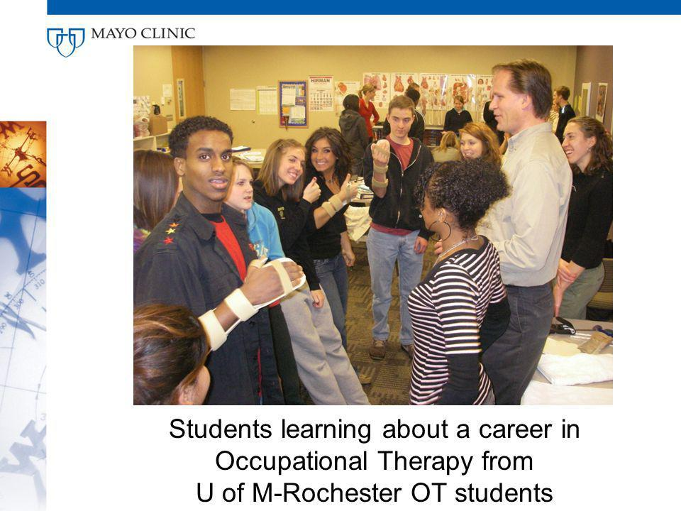 Students learning about a career in Occupational Therapy from U of M-Rochester OT students