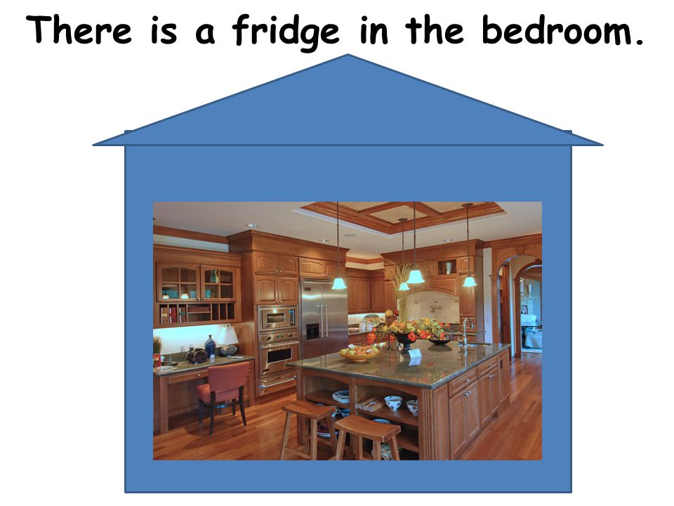 There is a fridge in the bedroom.