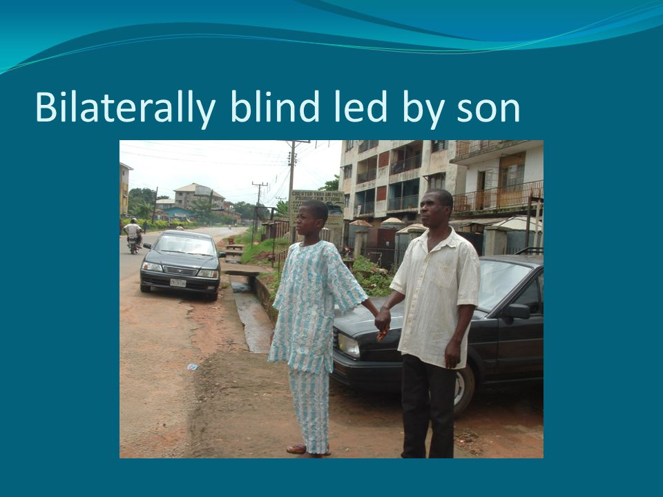 Bilaterally blind led by son