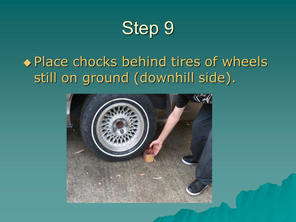 Step 9 Place chocks behind tires of wheels still on ground (downhill side). Place chocks behind tires of wheels still on ground (downhill side).