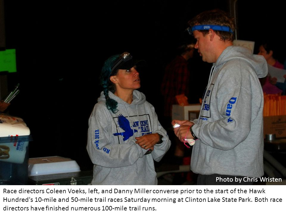 Race directors Coleen Voeks, left, and Danny Miller converse prior to the start of the Hawk Hundred s 10-mile and 50-mile trail races Saturday morning at Clinton Lake State Park.