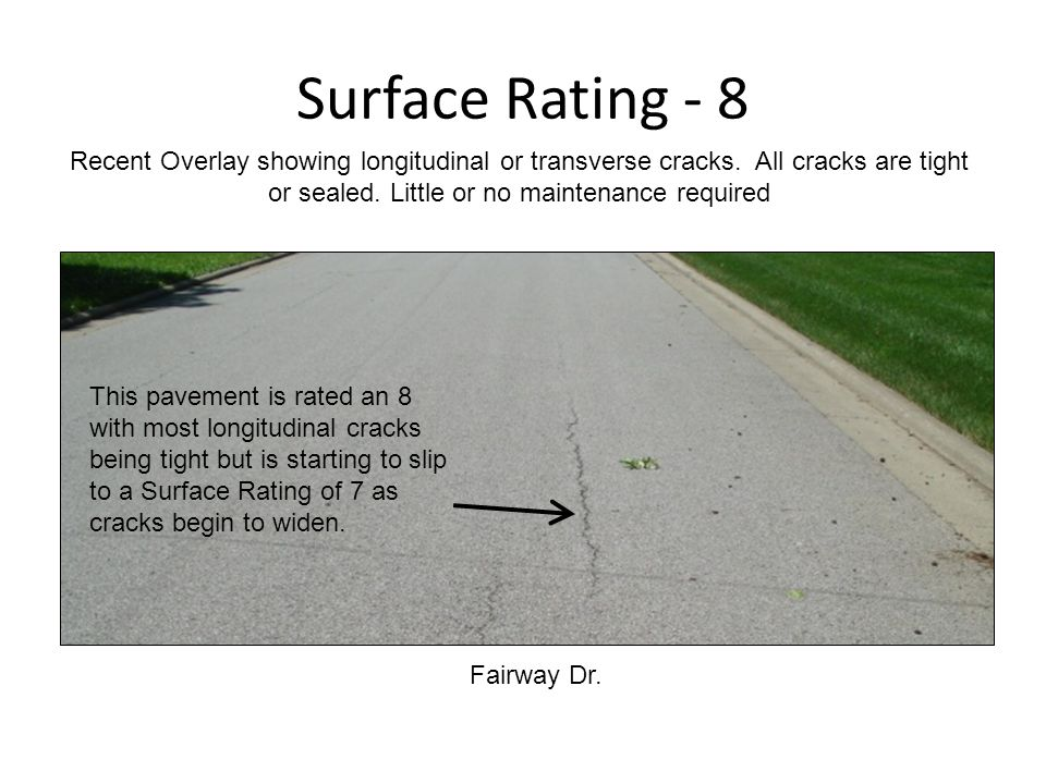 Surface Rating - 8 Fairway Dr. Recent Overlay showing longitudinal or transverse cracks.