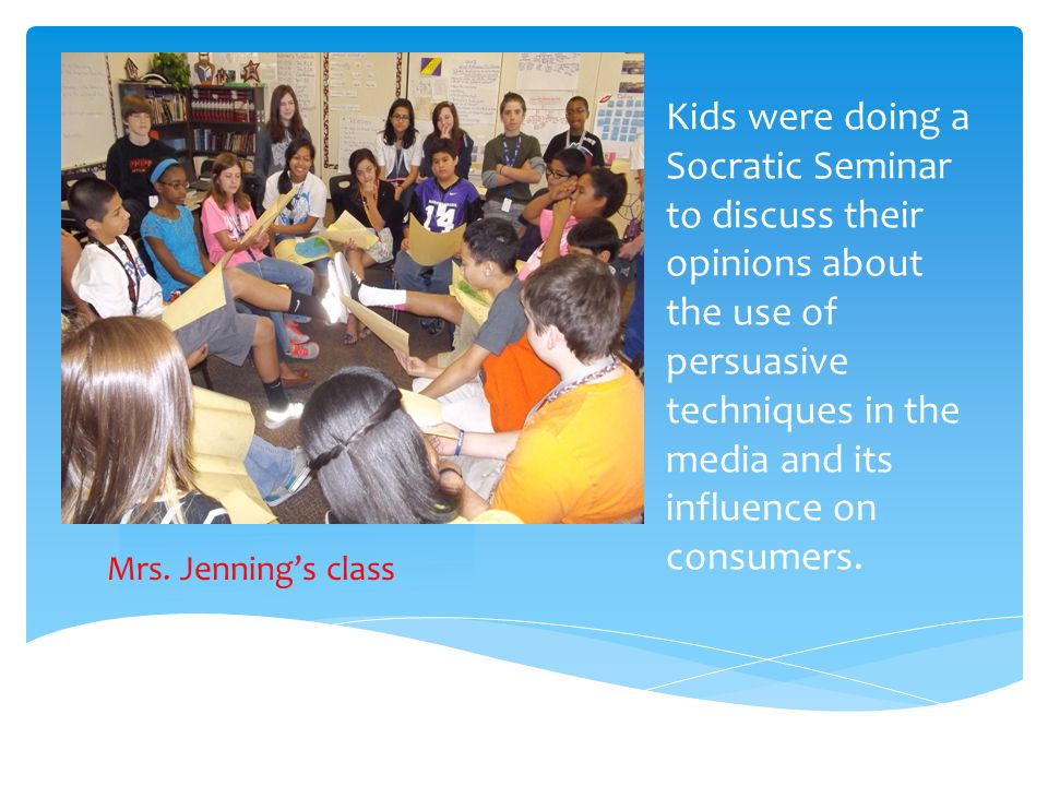 Kids were doing a Socratic Seminar to discuss their opinions about the use of persuasive techniques in the media and its influence on consumers. Mrs.