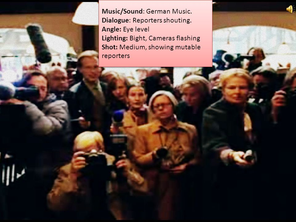Music/Sound: German Music.Dialogue: Augustus Angle: Low, showing the kid and his ticket.