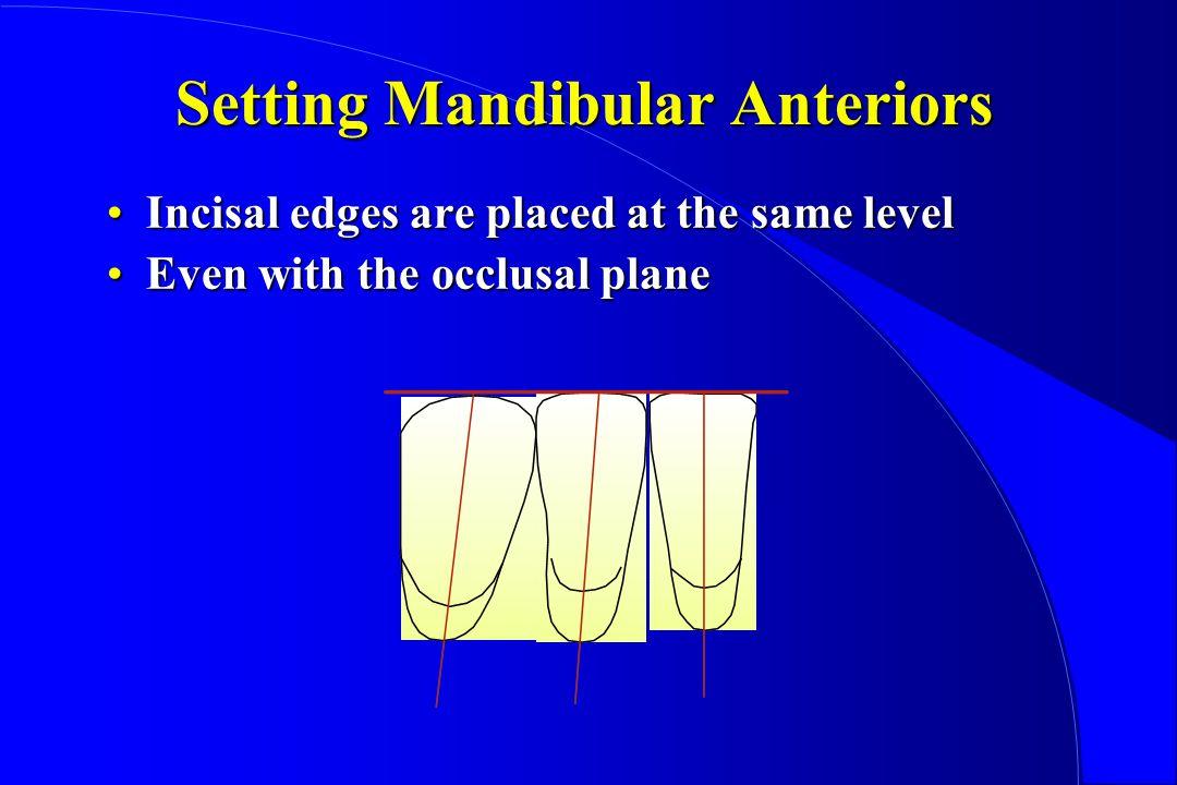 Setting Mandibular Anteriors Incisal edges are placed at the same levelIncisal edges are placed at the same level Even with the occlusal planeEven with the occlusal plane