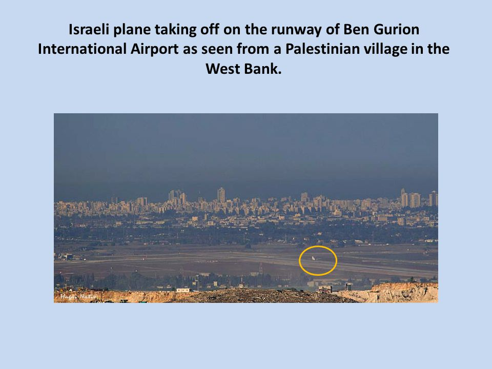 Israeli plane taking off on the runway of Ben Gurion International Airport as seen from a Palestinian village in the West Bank.