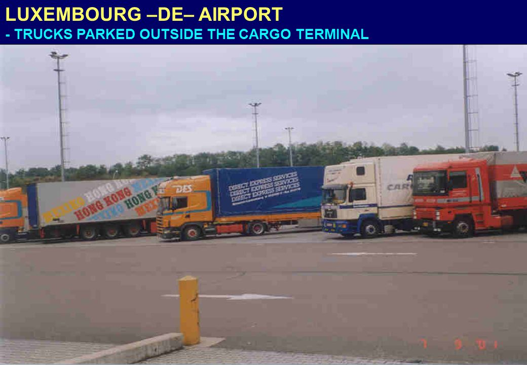 LUXEMBOURG –DE– AIRPORT - TRUCKS PARKED OUTSIDE THE CARGO TERMINAL