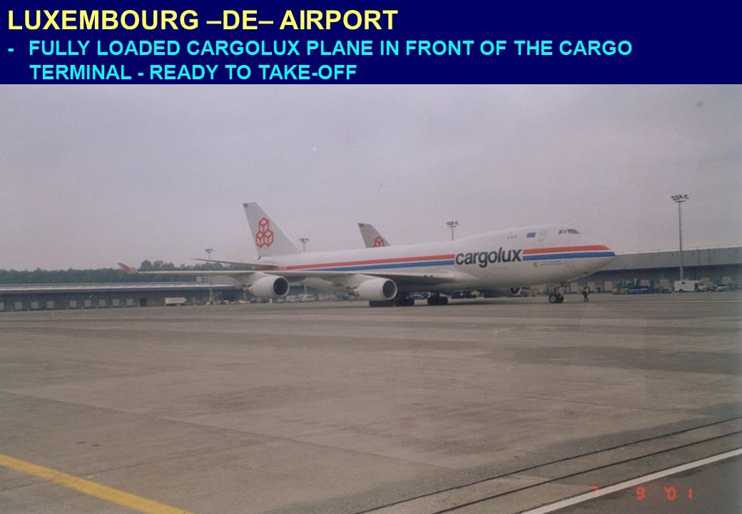 LUXEMBOURG –DE– AIRPORT - FULLY LOADED CARGOLUX PLANE IN FRONT OF THE CARGO TERMINAL - READY TO TAKE-OFF