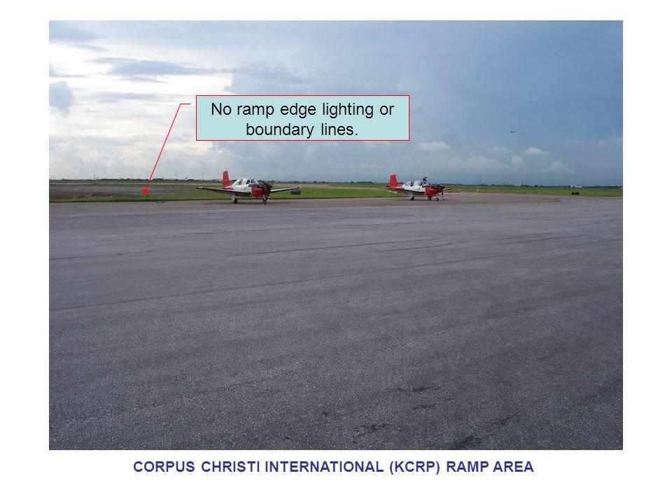No ramp edge lighting or boundary lines. CORPUS CHRISTI INTERNATIONAL (KCRP) RAMP AREA