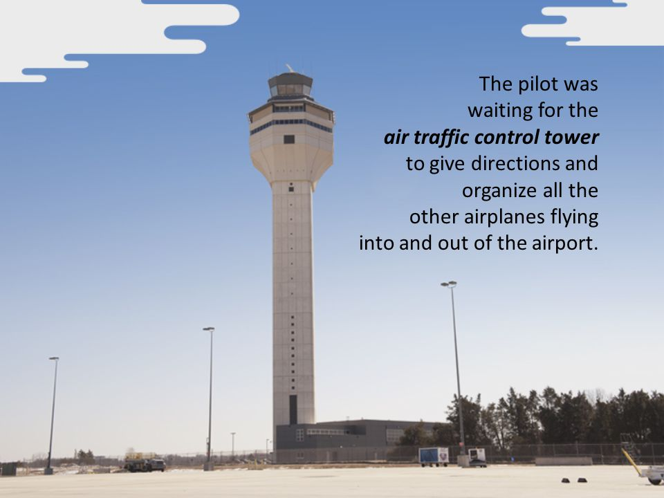 The pilot was waiting for the air traffic control tower to give directions and organize all the other airplanes flying into and out of the airport.