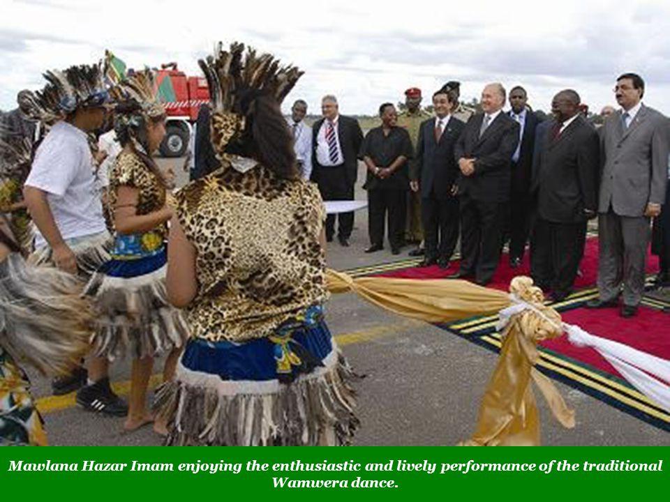 Mawlana Hazar Imam enjoying the enthusiastic and lively performance of the traditional Wamwera dance.