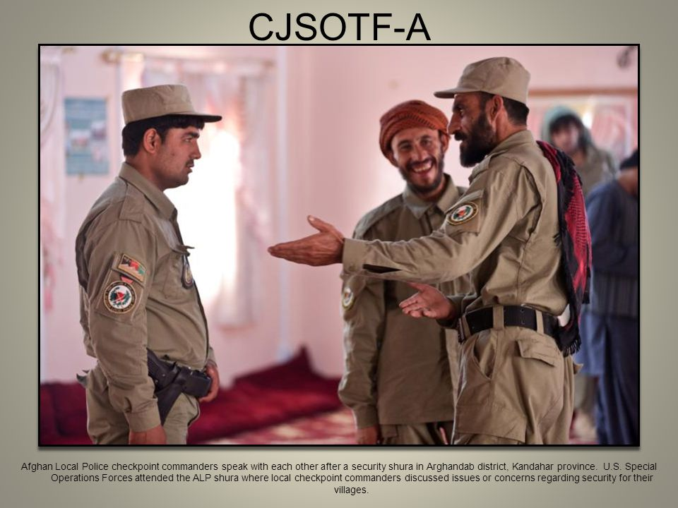 CJSOTF-A Afghan Local Police checkpoint commanders speak with each other after a security shura in Arghandab district, Kandahar province. U.S. Special