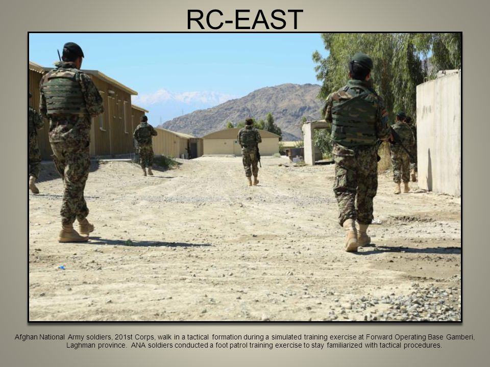 RC-EAST Afghan National Army soldiers, 201st Corps, walk in a tactical formation during a simulated training exercise at Forward Operating Base Gamber