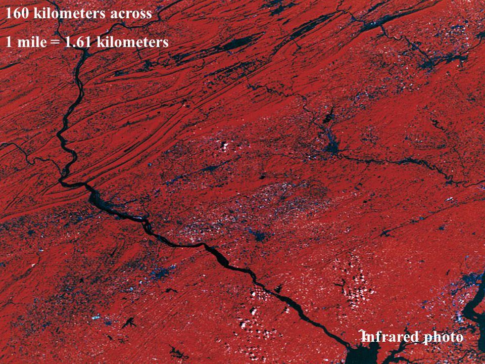 160 kilometers across 1 mile = 1.61 kilometers Infrared photo