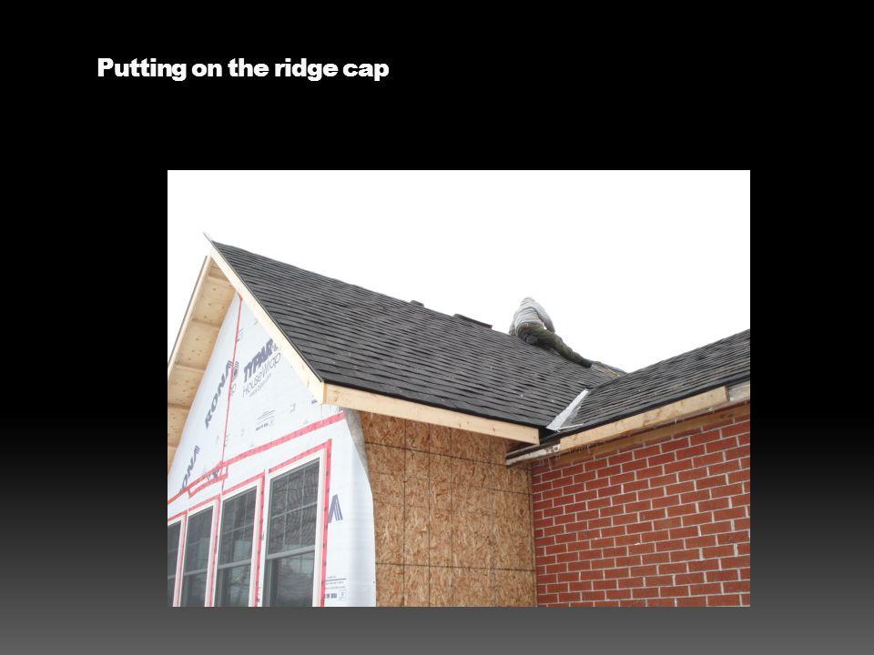 Putting on the ridge cap