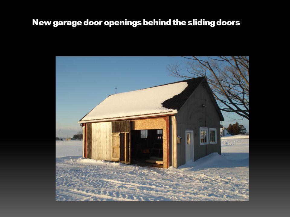 New garage door openings behind the sliding doors