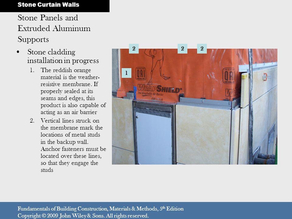 Stone cladding installation in progress 1.The reddish orange material is the weather- resistive membrane.