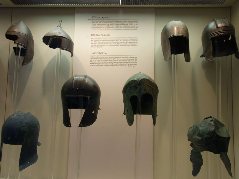 In this panel, there are two Persian helmets. If you look at a Greek helmet, you will notice that the top is not going to deflect a sword, axe, or blu
