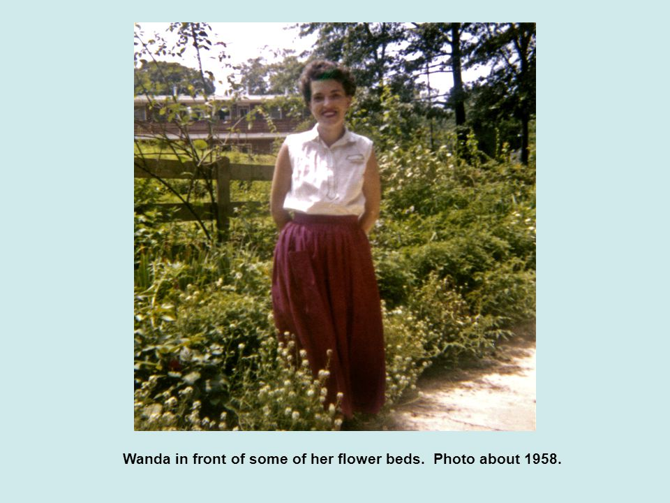 Wanda in front of some of her flower beds. Photo about 1958.