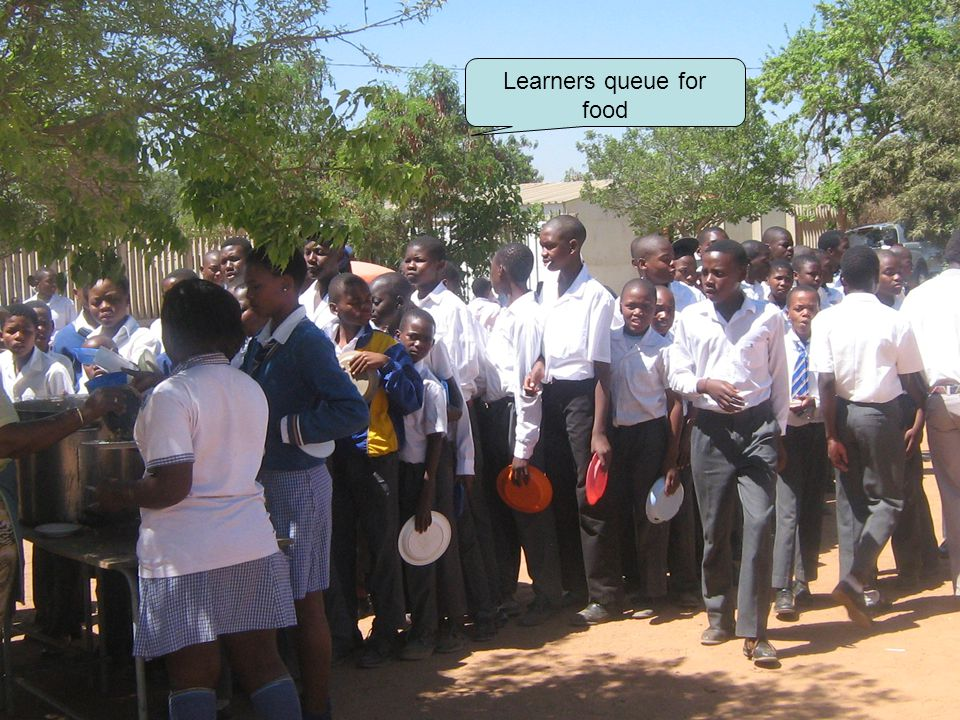 Learners queue for food
