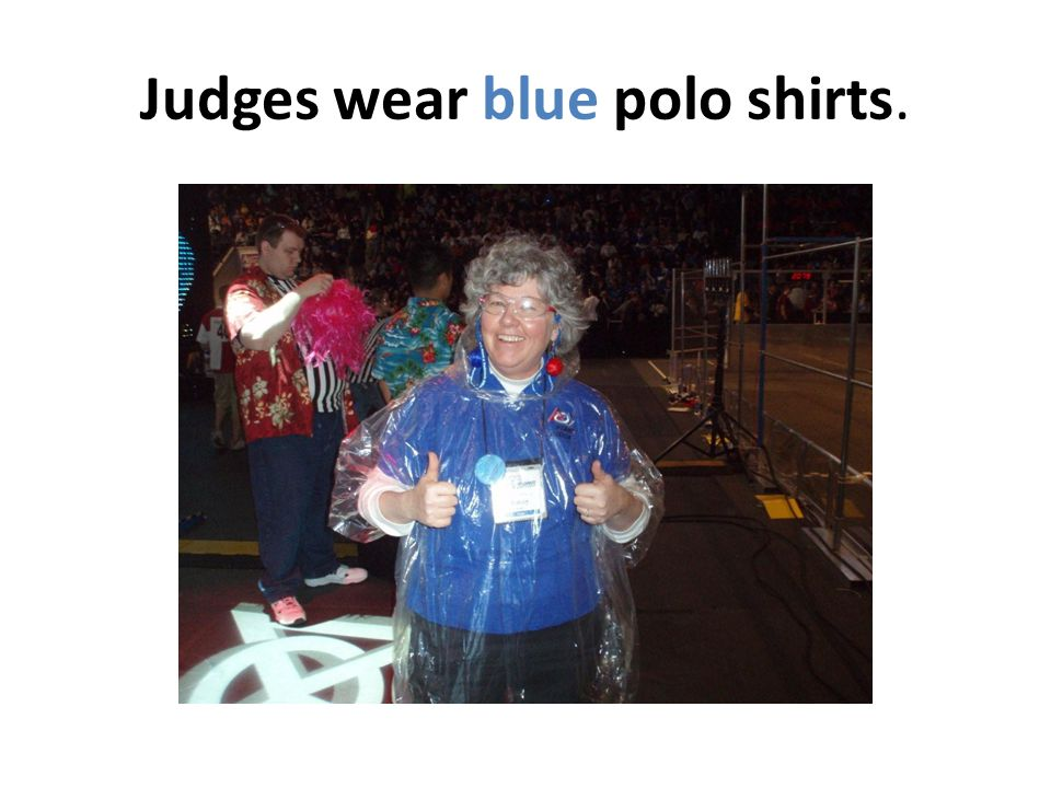Judges wear blue polo shirts.