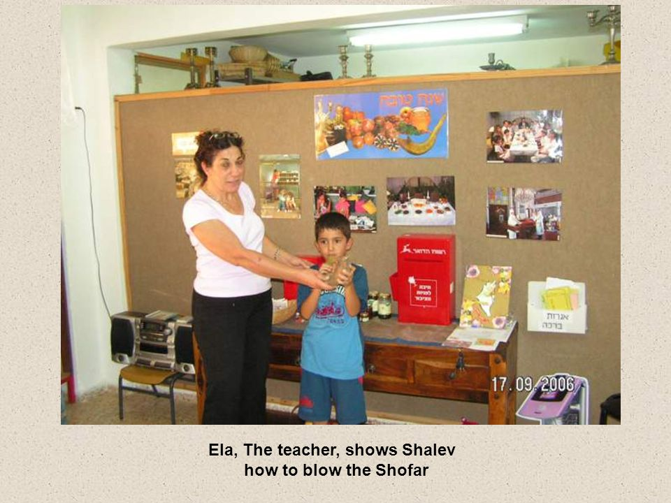 Ela, The teacher, shows Shalev how to blow the Shofar