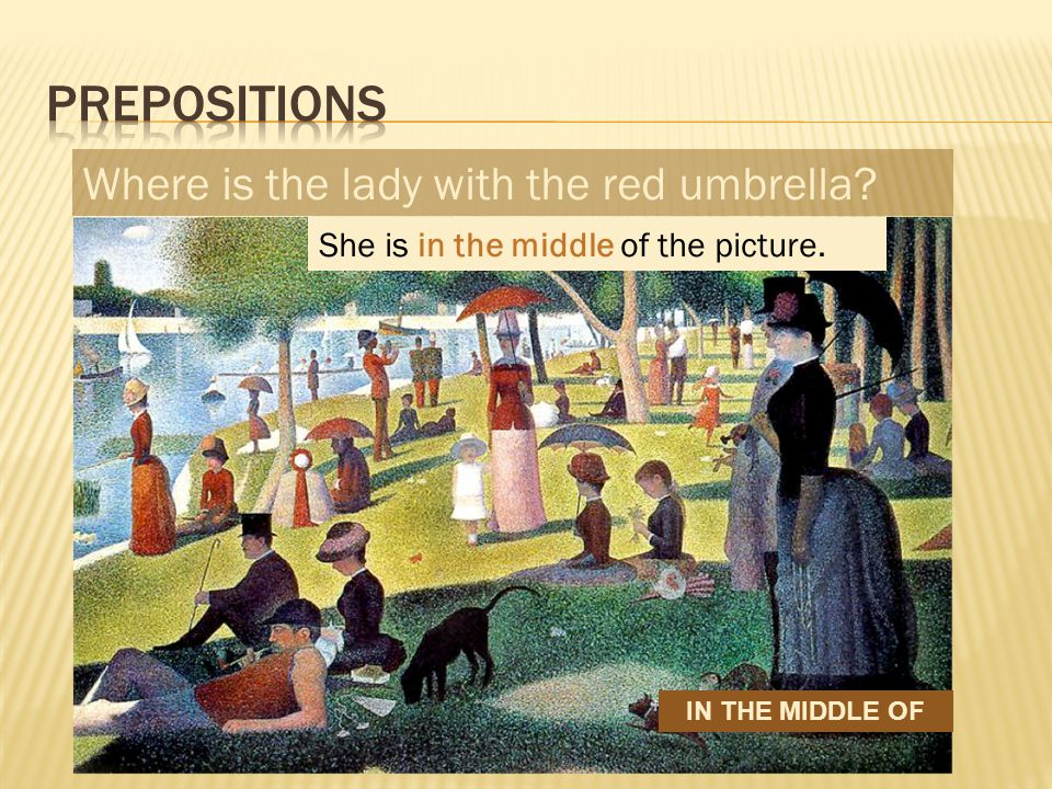 Where is the lady with the red umbrella She is in the middle of the picture. IN THE MIDDLE OF