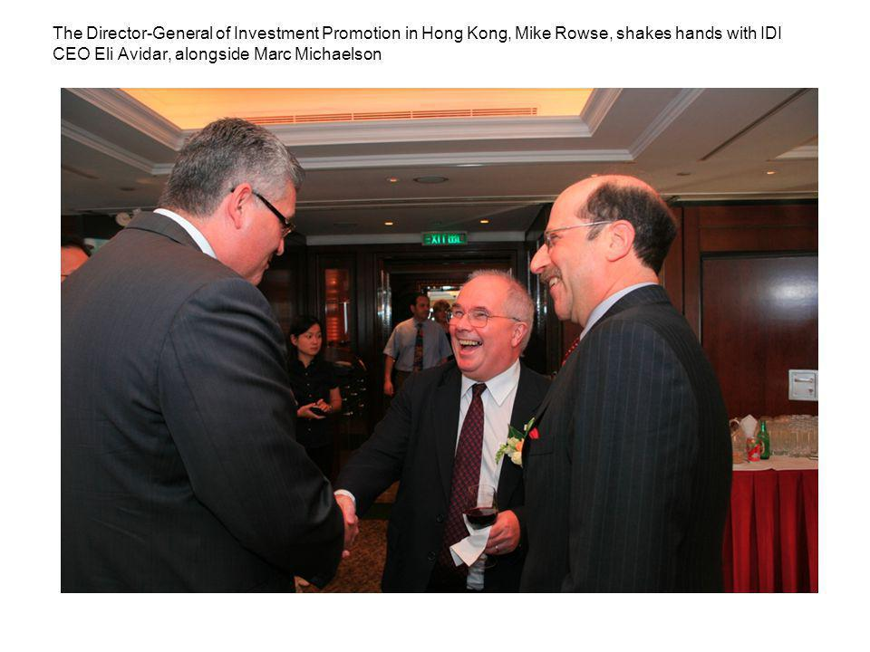 The Director-General of Investment Promotion in Hong Kong, Mike Rowse, shakes hands with IDI CEO Eli Avidar, alongside Marc Michaelson