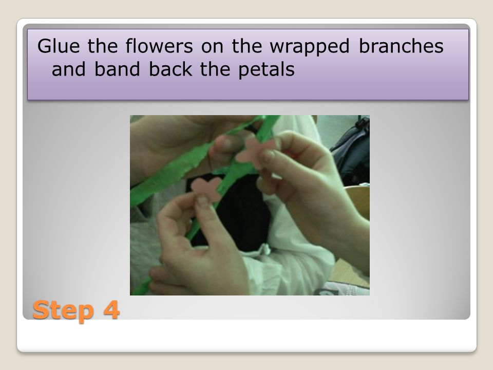 Step 4 Glue the flowers on the wrapped branches and band back the petals