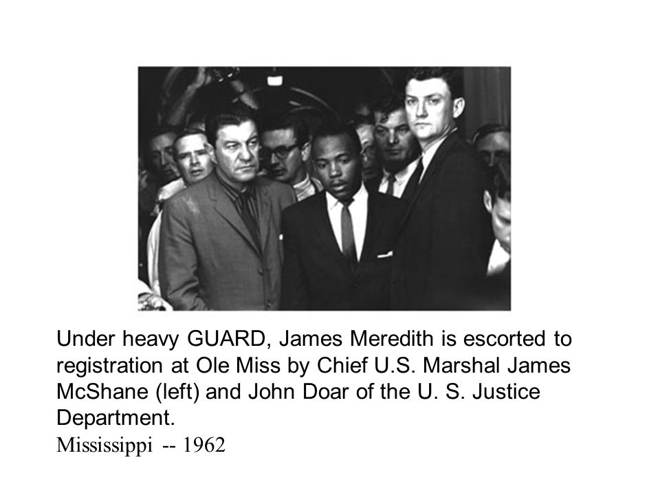 Under heavy GUARD, James Meredith is escorted to registration at Ole Miss by Chief U.S. Marshal James McShane (left) and John Doar of the U. S. Justic