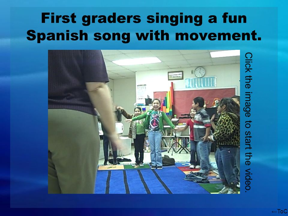 ToC First graders singing a fun Spanish song with movement. Click the image to start the video.