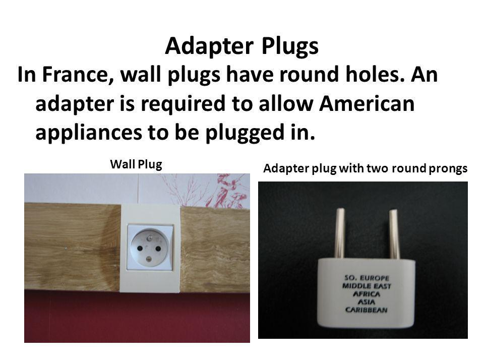 Adapter Plugs In France, wall plugs have round holes.