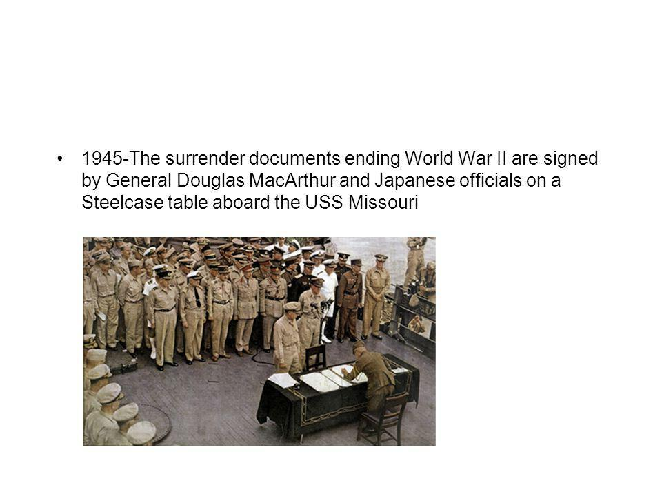 1945-The surrender documents ending World War II are signed by General Douglas MacArthur and Japanese officials on a Steelcase table aboard the USS Mi