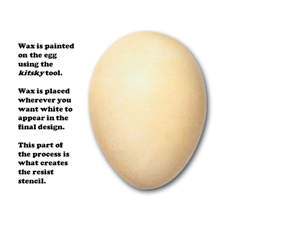 Wax is painted on the egg using the kitsky tool. Wax is placed wherever you want white to appear in the final design. This part of the process is what