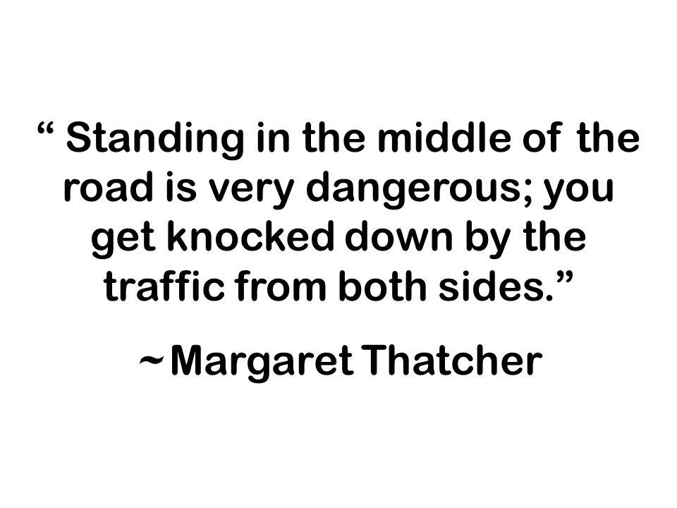 Standing in the middle of the road is very dangerous; you get knocked down by the traffic from both sides.